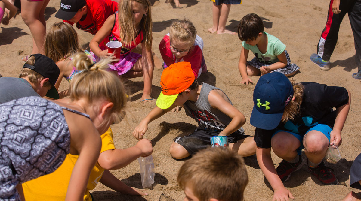 Kids Searching in Sand